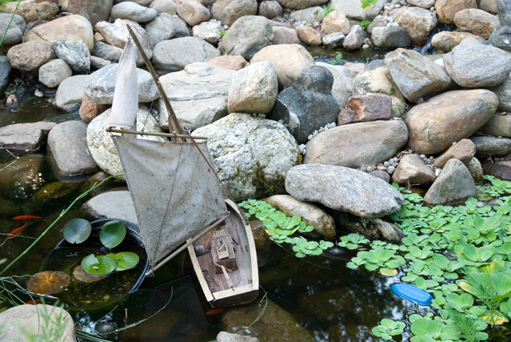 dsc_6296-toy-boat-on-rocks.jpg