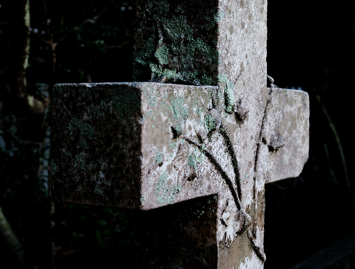 """One of the great pleasures on Ocracoke is exploring its old cemeteries. Small family plots can be found all over the town, full of art, history and antiquities to share with a traveler who stops by to visit a spell. This simply carved cross, covered with lichen, now has a splendid patina earned with age.""  --RM--"