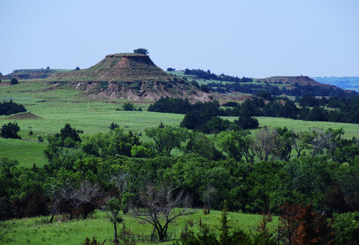 """Crossing the bottom of Kansas to the west is the Gypsum Hills. Cool ancient formations of red shale and sandstone buttes. The iron in the soil rusts when exposed, creating the """"Red"""" Hills for a 42 mile stretch of painted landscape. — RM —"""