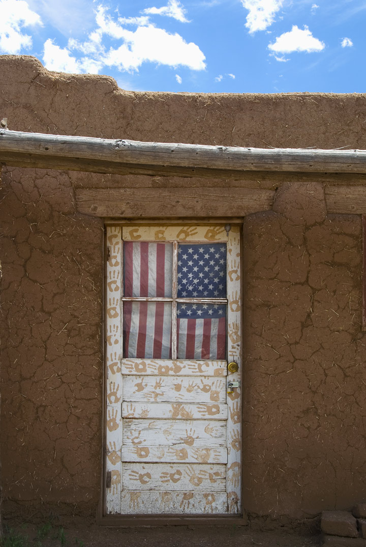 Love of Country takes many forms, and this door in the Taos Pueblo was a particularly great visual of that.  The color of the adobe against the sky, the hand prints which almost look like a bears, and Old Glory offering protection from a prying public was our last view leaving the pueblo.  It is a magnificent place, but also rather sad to me.  I felt like an intruder rather than a guest.  --- RM ---