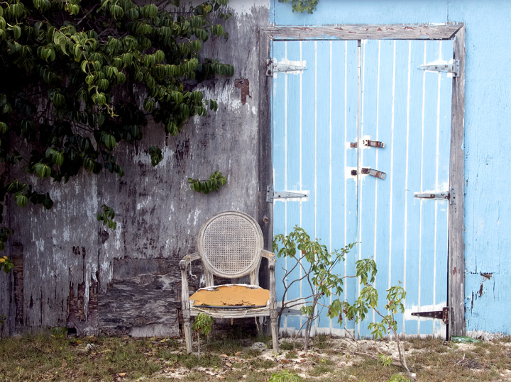 As color is exposed to the Caribbean sun, it often becomes even more inviting.  The driftwood grays set off this blue door to a tee. — RM —