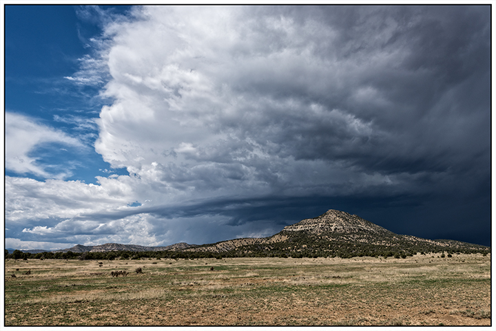 DSC_6579-pointed-hill-with-storm-clouds-east-of-Cimarron